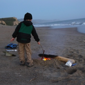 Making s'mores on the beach