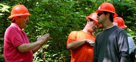 Biologists from Save the Redwoods League meet with foresters in the field to discuss restoration